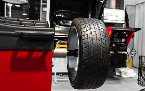tire is sitting on tire balancing machine