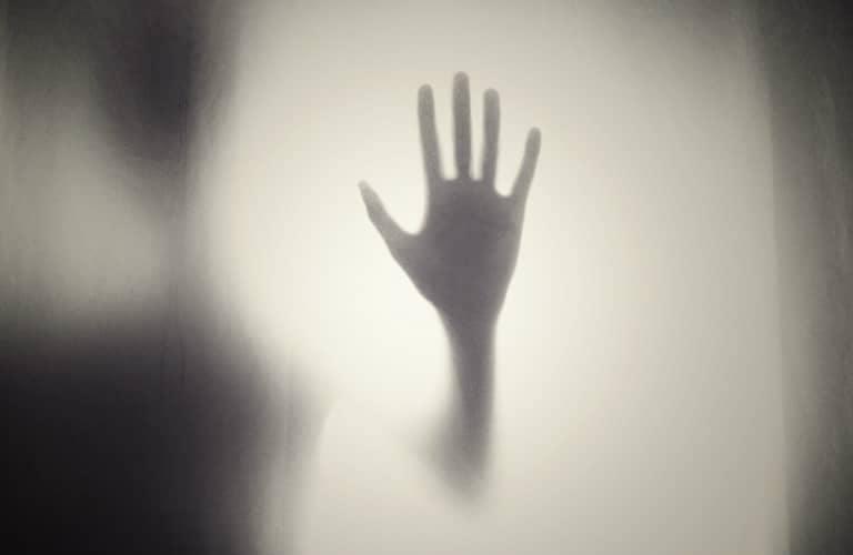 ghostly_hand_on_window_768x500_b
