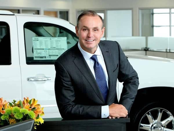 Todd Wenzel Smiles in front of a white Truck