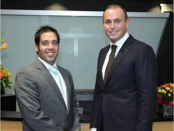 Todd Wenzel Smiles with an employee