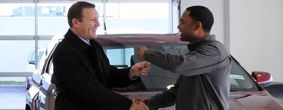 Todd Wenzel salesmen shakes hands with customer