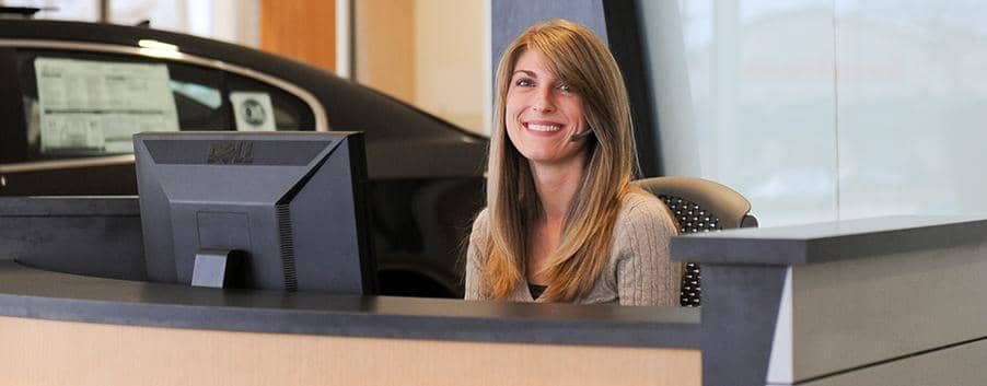 ToddWenzel Receptionnist smiles at the camera