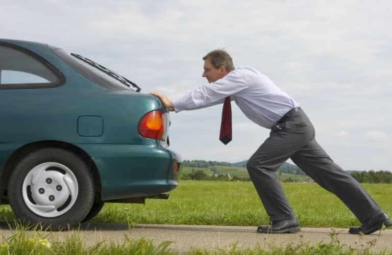 man_pushing_car_768x500_b