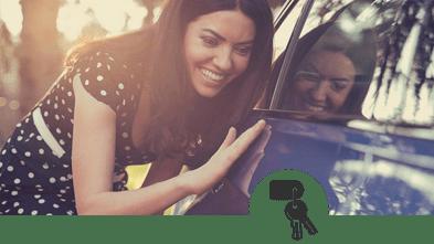 a woman touching a car