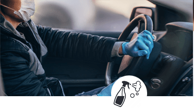 a-person-driving-a-car-wearing-a-mask-and-gloves