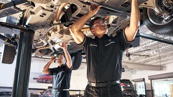 Service technician working on car