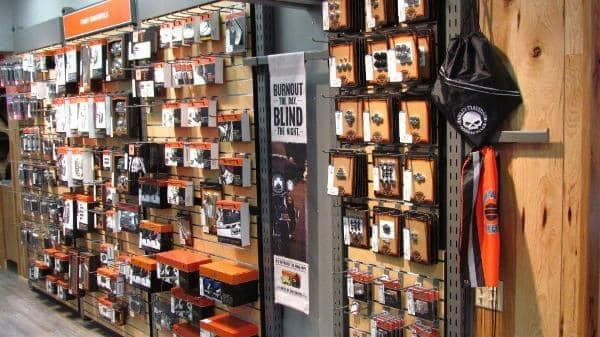 One wall in Top Rocker Harley Davidson store displaying parts hung in rows on the wall