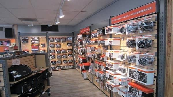 Harley Davidson parts hung on walls of Top Rocker Harley Davidson store