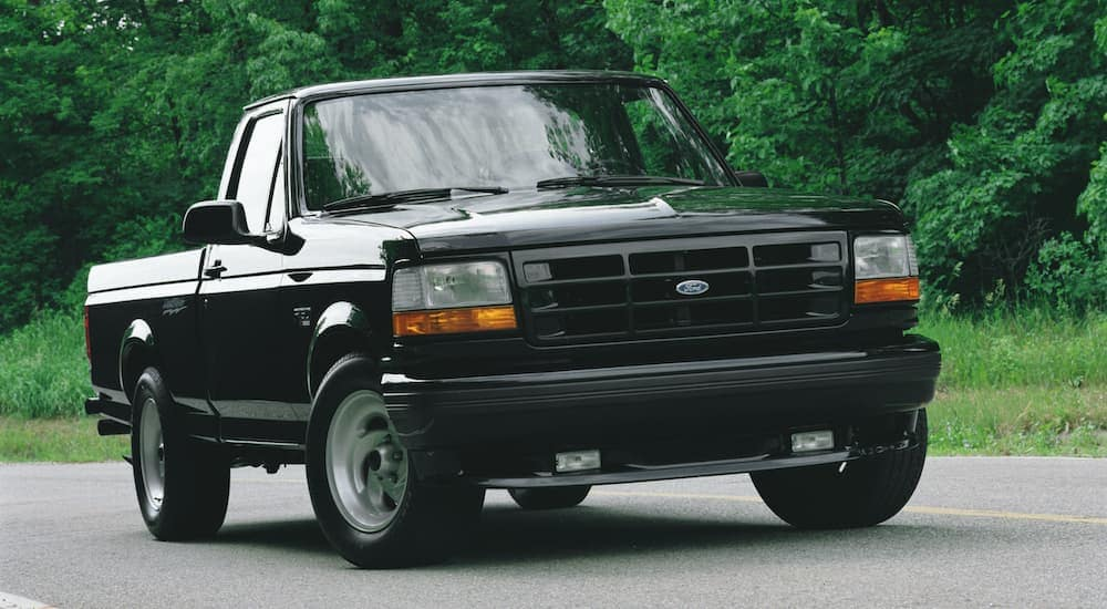 A black 1993 Ford F-150 SVT Lightning is shown from the front parked on pavement.