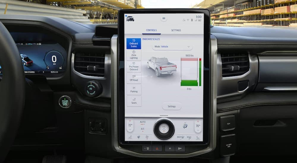 A close up shows the large infotainment screen in a 2022 Ford F-150 Lightning Lariat.