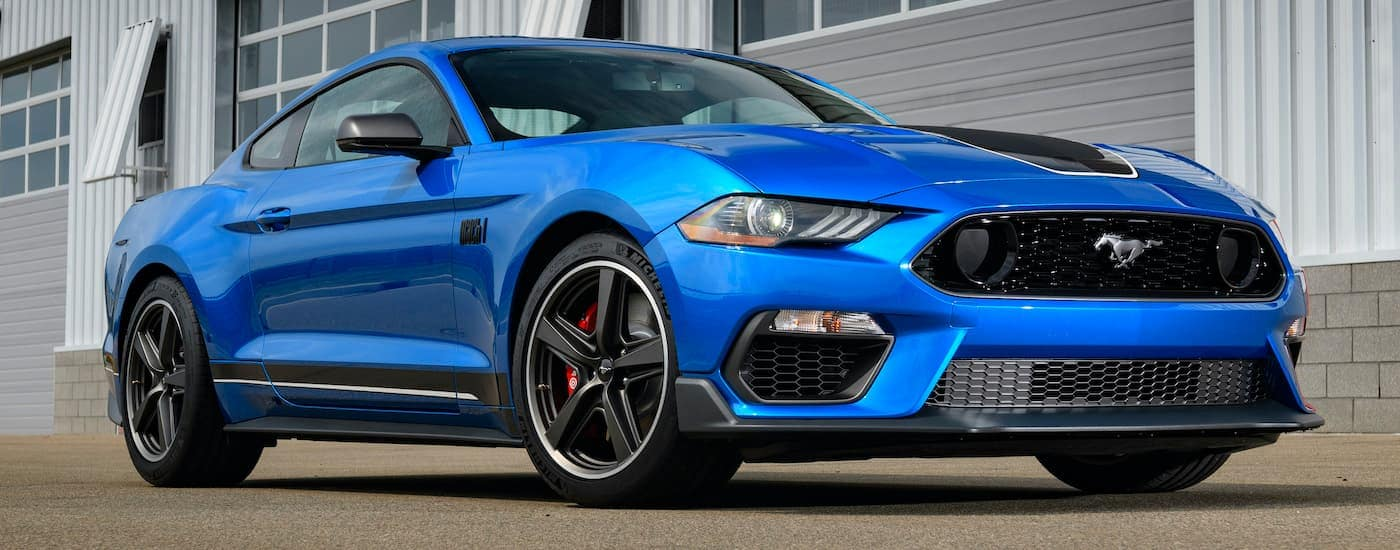 A blue 2021 Ford Mustang Mach 1 is shown form the side at a low angle.