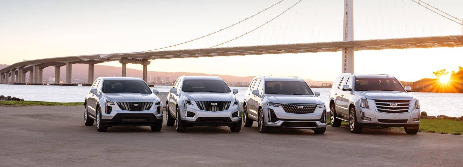 2020 Cadillac line-up in front of bridge