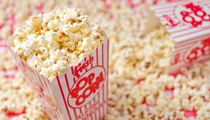 Bag of popcorn sitting on a large pile of popcorn