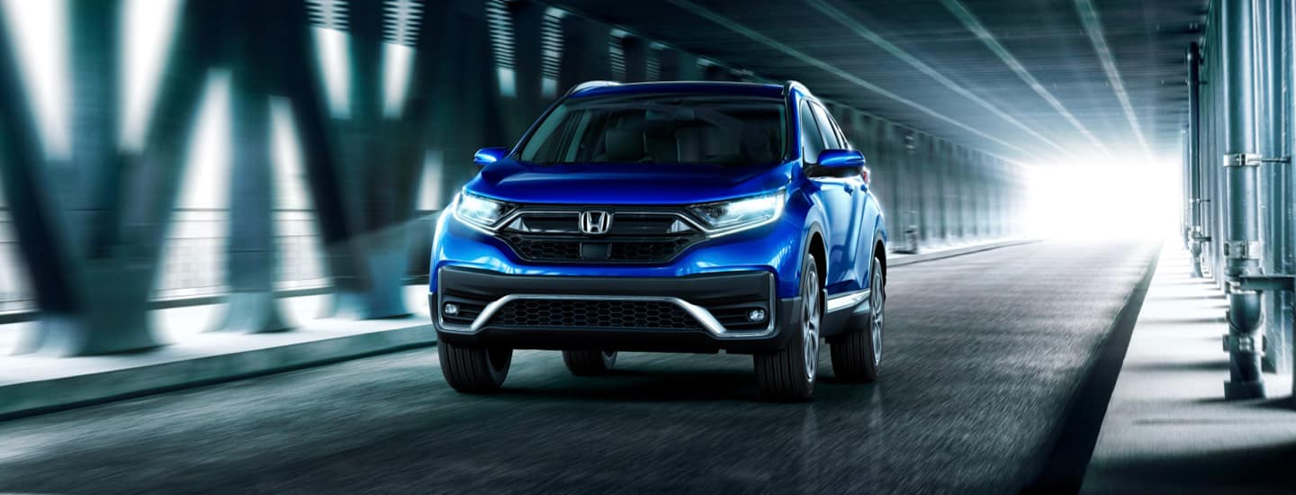 Blue Honda SUV on Bridge