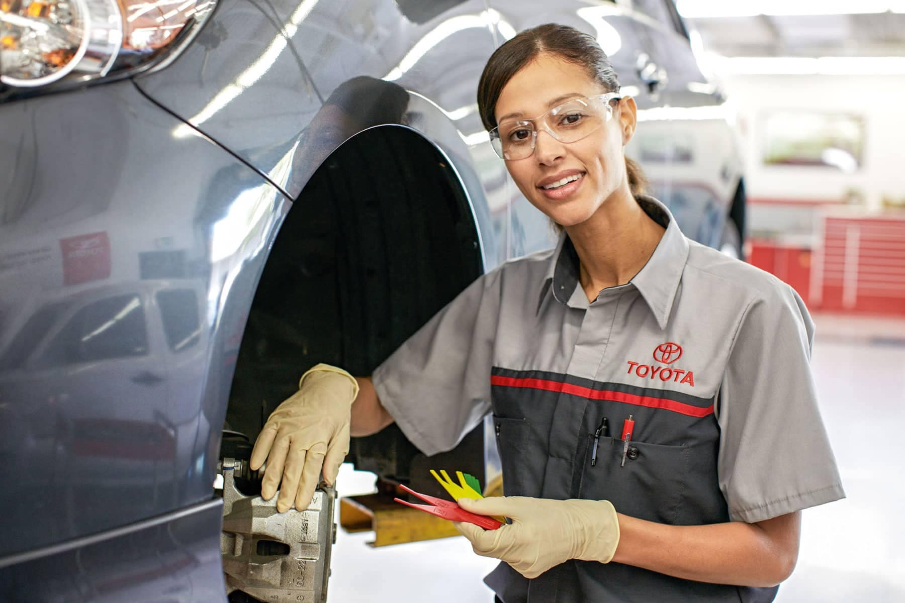 Toyota service technician working on brakes