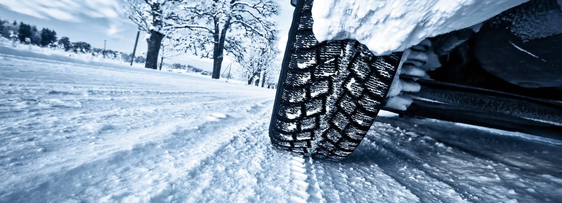 Tire picture of car driving through snow