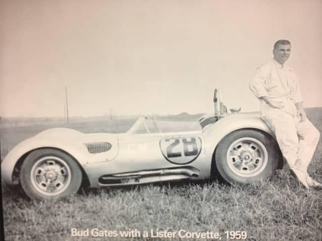 Bud Gates leaning against a Lister Corvette in 1959