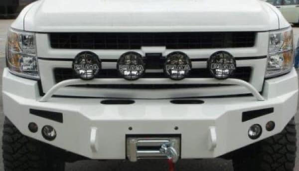 The customized grill of a white chevy truck