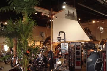 Palm tree and ship sails in motorcycle showroom