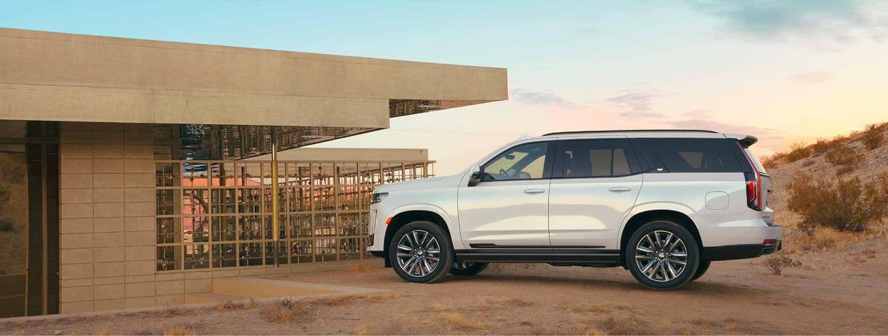 2021 escalade parked at modern building in desert