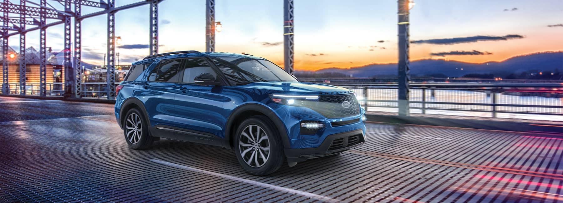 Blue 2021 Ford Explorer crossing a suburban bridge_mobile