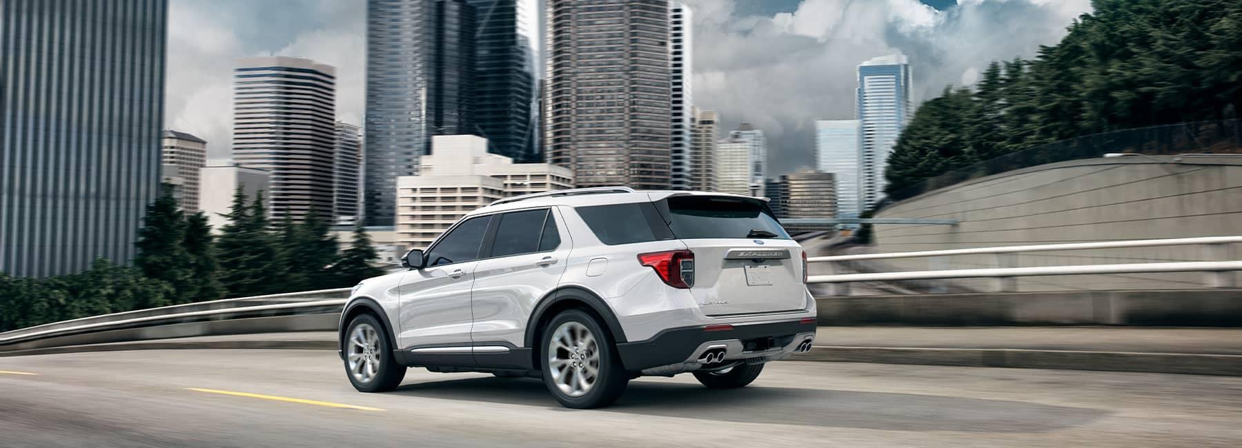 White 2021 Ford Explorer driving through a metropolis