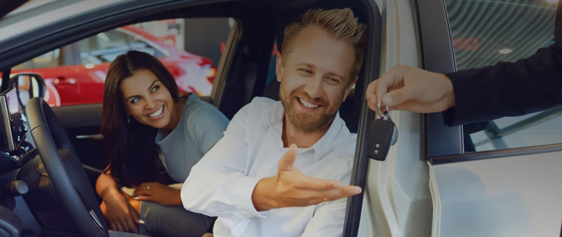Couple Accepts Car Key while sitting in car