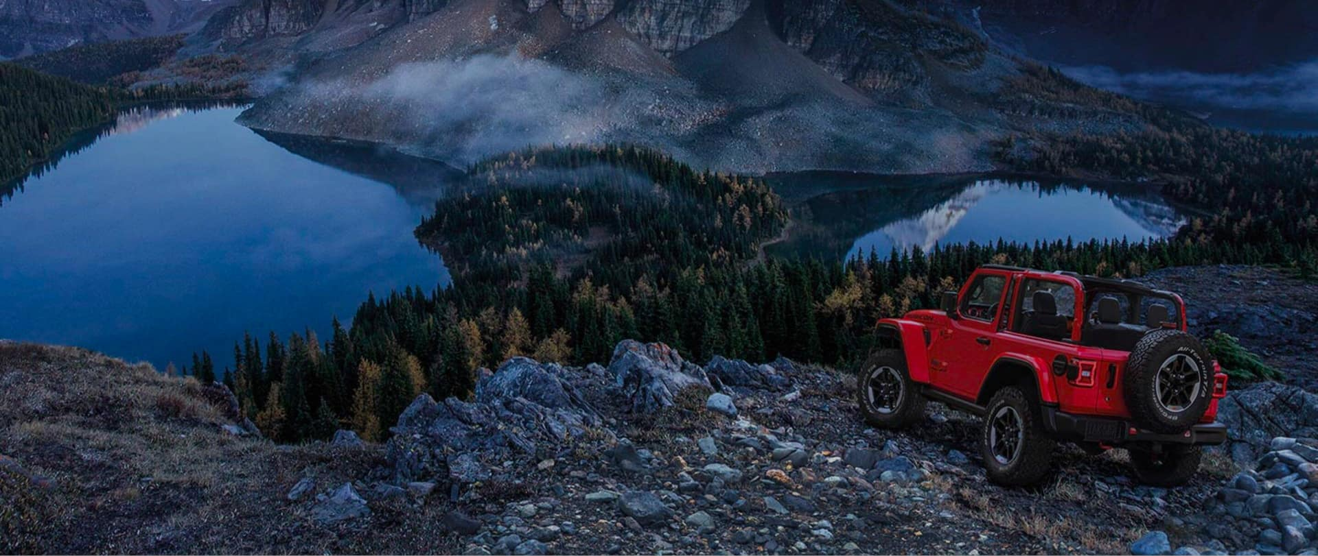 Jeep offroad overlooking lake