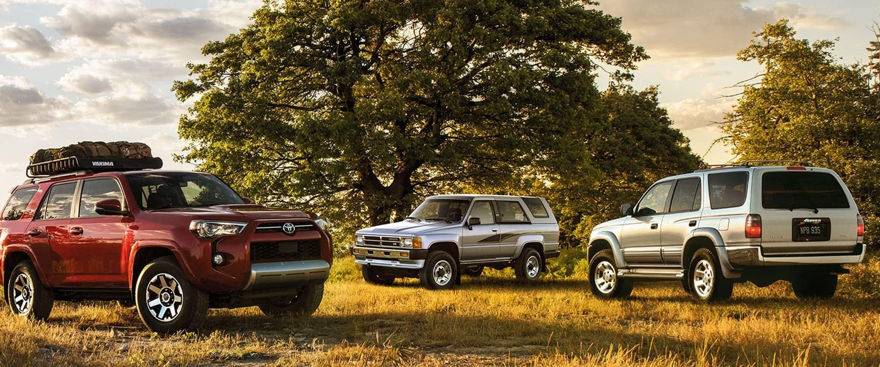 3 Toyota 4Runners sitting in an open field