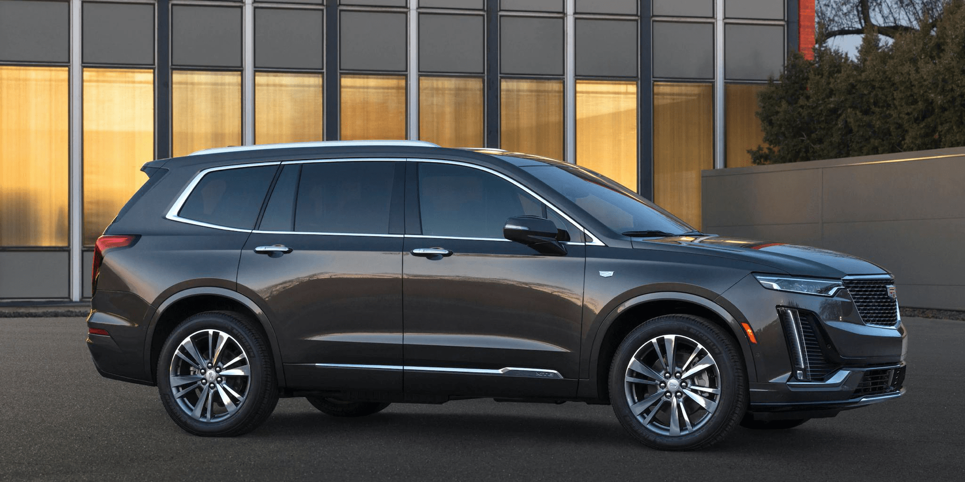 2020 Cadillac XT6 parked outside modern home