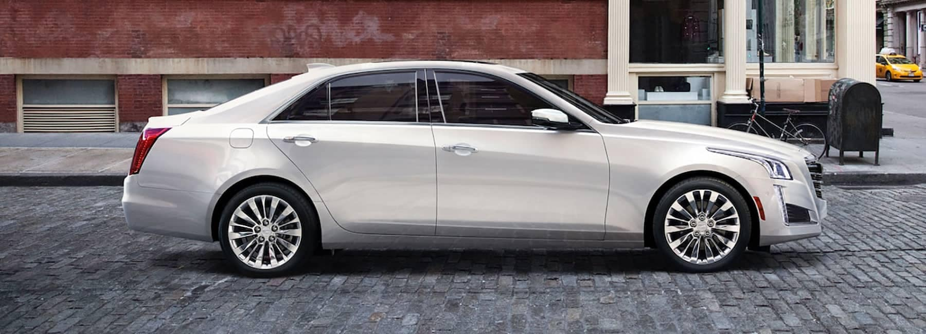 Cadillac-CTS-Sedan parked on bricked street