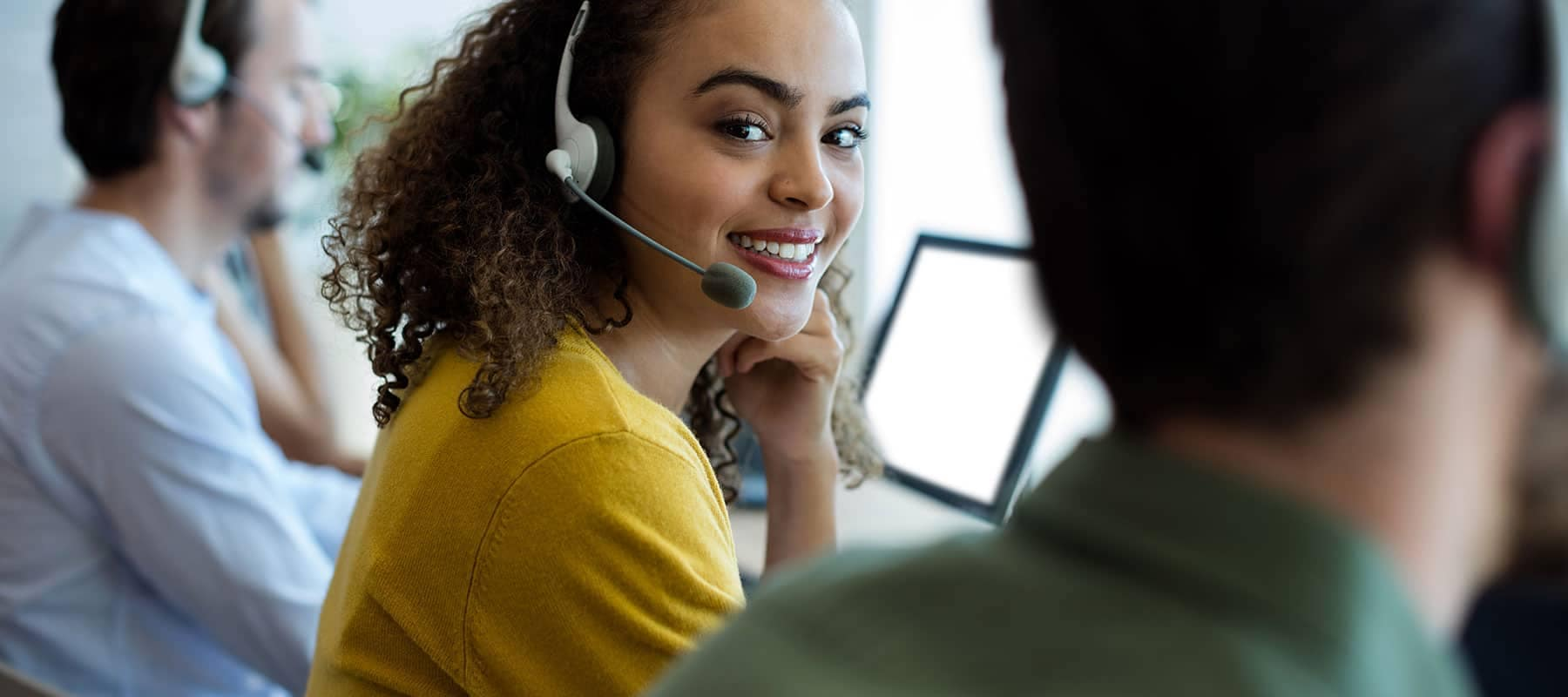 customer service rep answers call in her headset