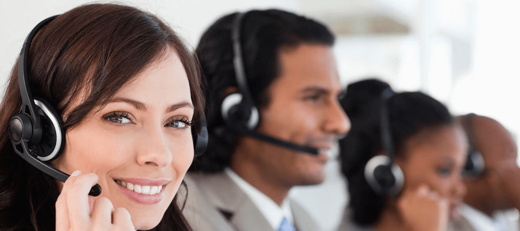 Customer service reps on headsets