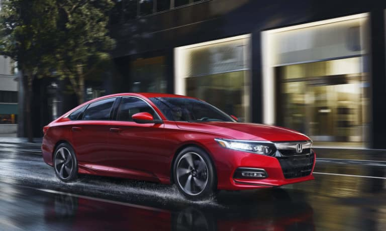New Red Honda Accord driving in the rain