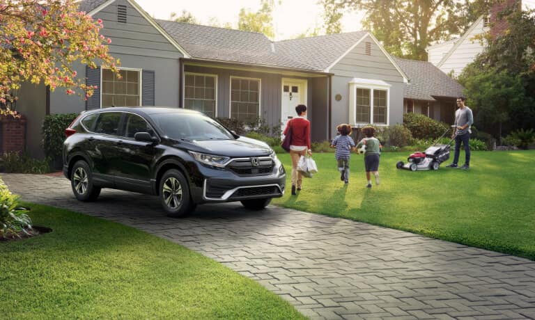 New Honda CR_V parked outside a family home