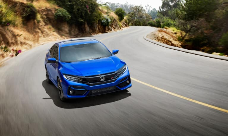 New Blue Honda Civic driving