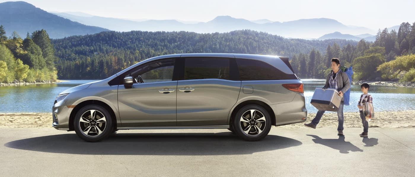 New Honda Odyssey parked at a lake