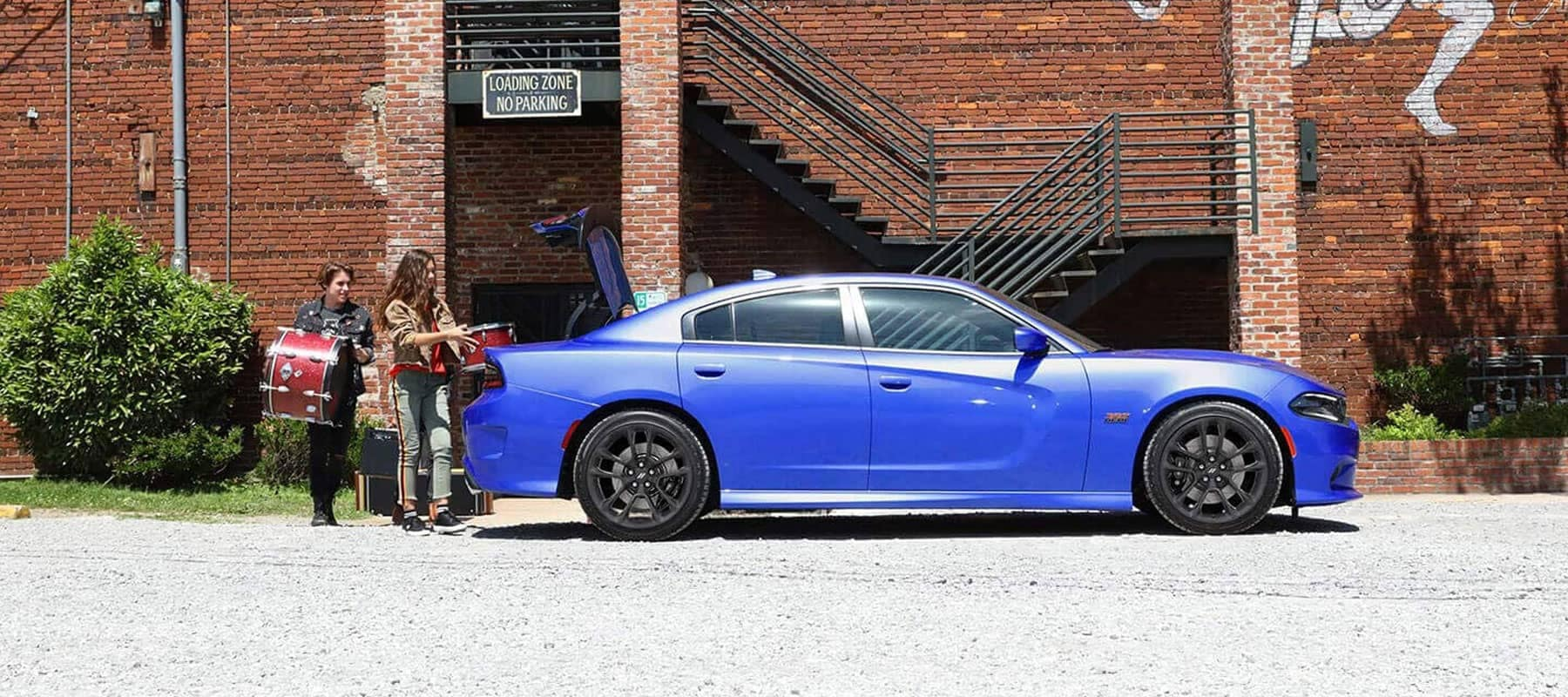 Blue 2021 Dodge Charger parked with the trunk popped