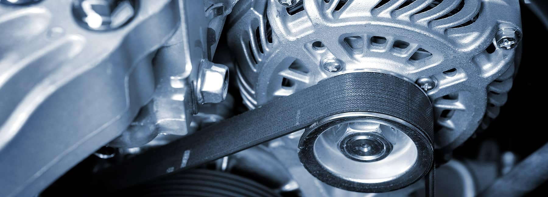 Close up of a belt on the engine of a vehicle