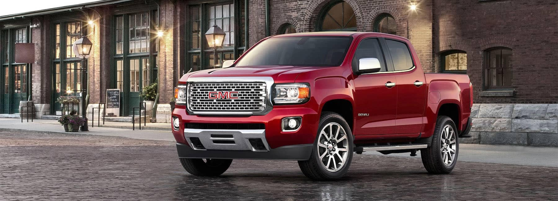 2020 Red GMC Canyon Denali Luxury Compact Pickup Truck Exterior Front Angle Shot