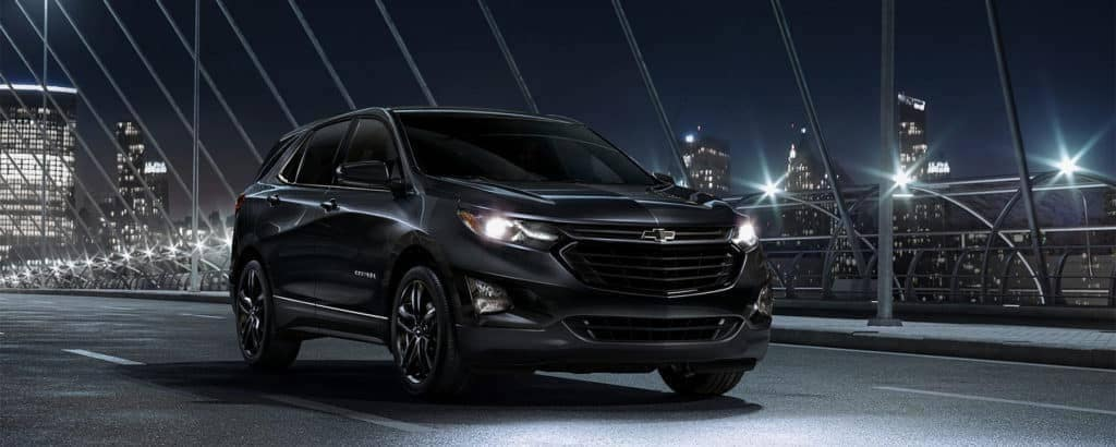 2020-Chevrolet-Equinox-driving-in-city-at-night-banner-1024x410
