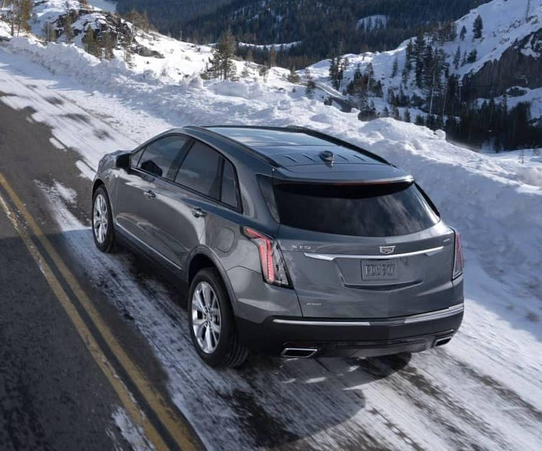 2020 Cadillac XT5 driving down snowy mountain road