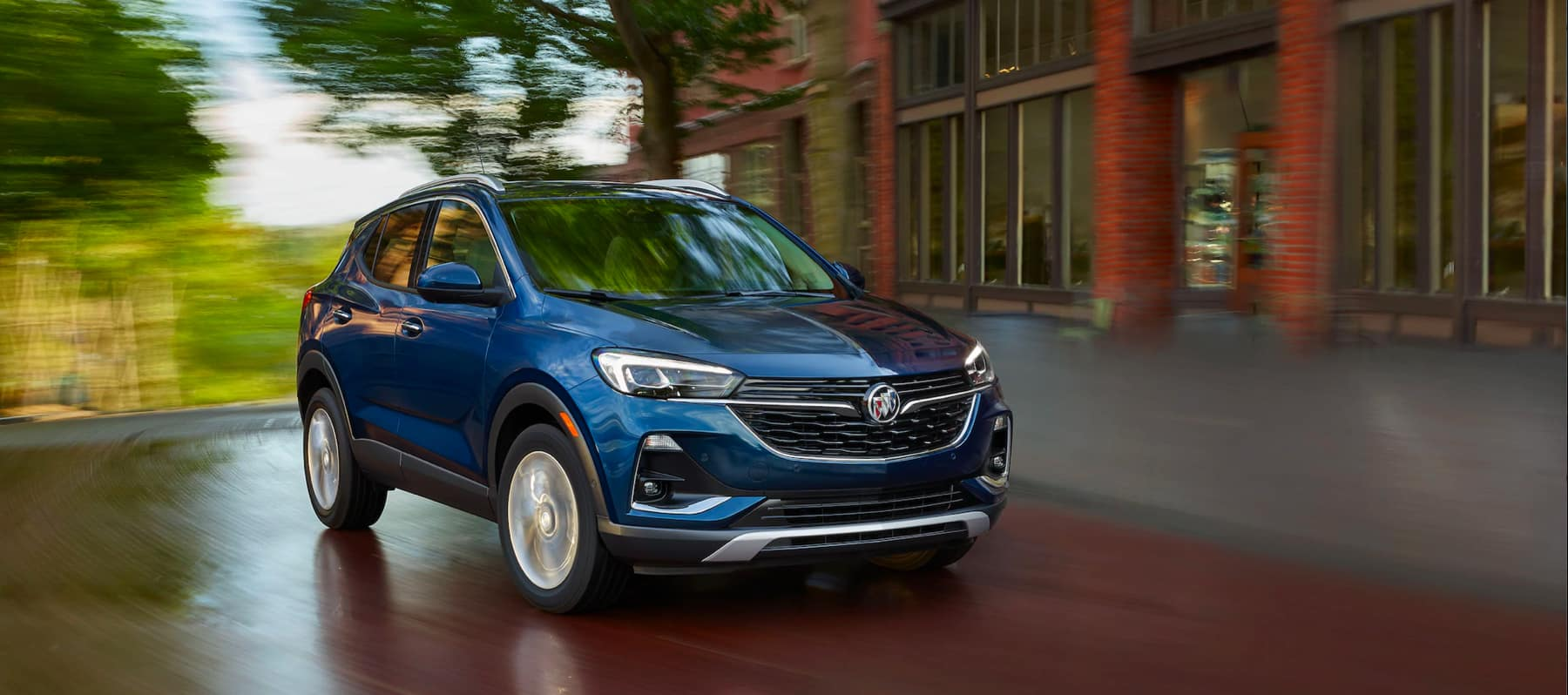 Buick Encore speeds past red bricked building