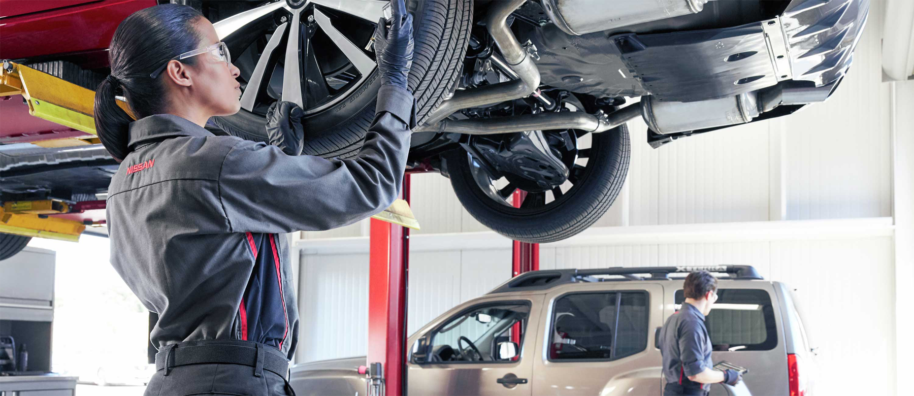 Technician-working-on-a-car-alignment