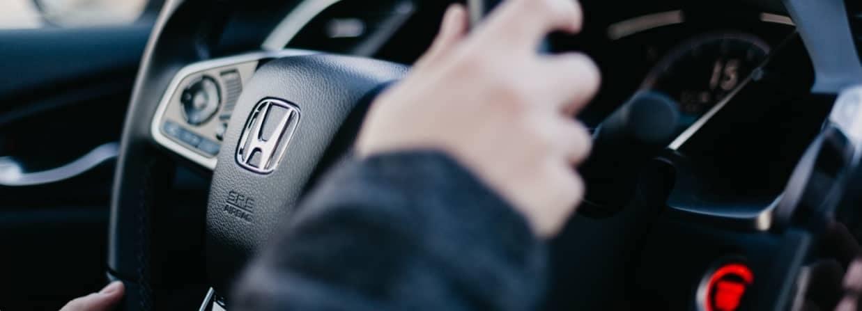 Person's Hands on Honda Steering Wheel