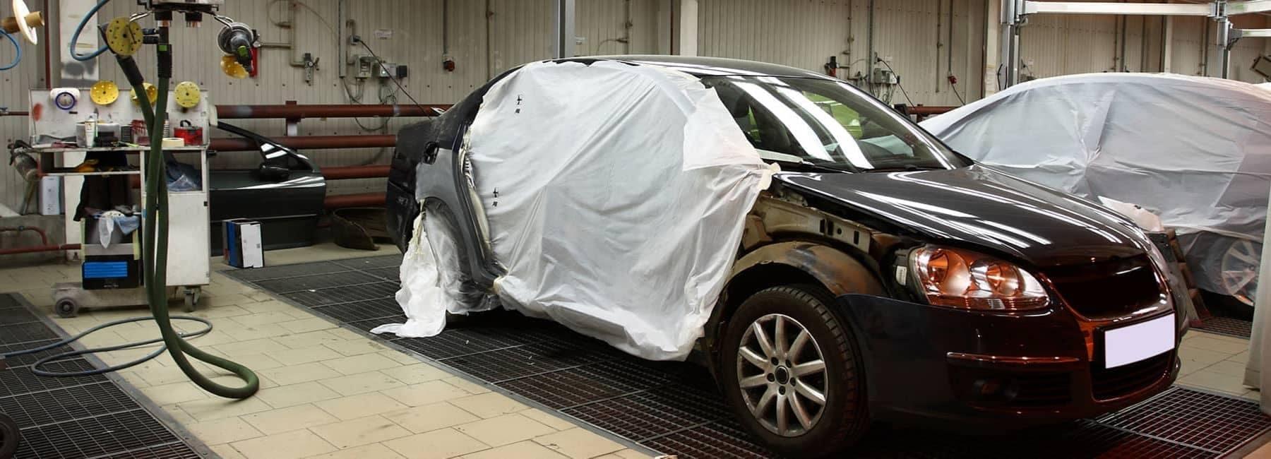 a car in a bodyshop