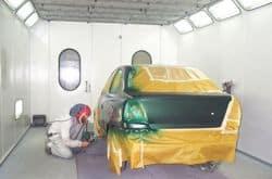 technician sprays car green