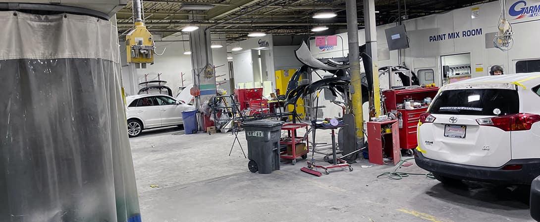 cars midway through their auto body job