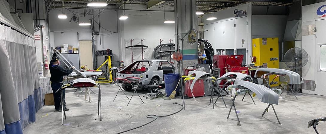 technician works in paint shop