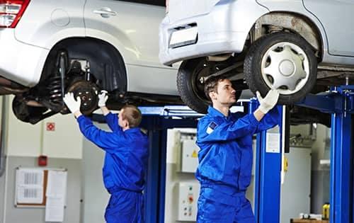 Mechanics working on cars